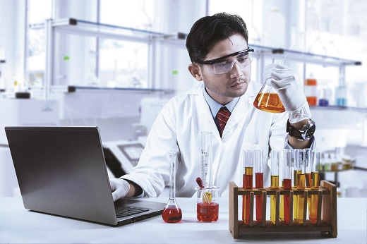 Asian chemist working in laboratory and doing research; Shutterstock ID 215669518; PO: EML i01 X51048