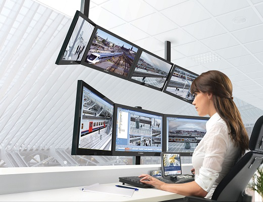 bvms surveillance woman screen computer monitor office